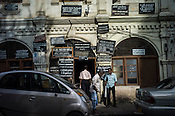 People seen outside an old colonial building in Central Sri Lanka.  Photo: Sanjit Das/Panos