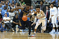 CHAPEL HILL, NC - NOVEMBER 06: Temple TJ Gibbs #10 of the University of Notre Dame is defended by Christian Keeling #55 of the University of North Carolina during a game between Notre Dame and North Carolina at Dean E. Smith Center on November 06, 2019 in Chapel Hill, North Carolina.