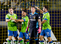 CARSON, CA - SEPTEMBER 27: Jordan Morris #13 of the Seattle Sounders scores a goal and celebrates with teammates Cristian Roldan #7 and Will Bruin #17 during a game between Seattle Sounders FC and Los Angeles Galaxy at Dignity Heath Sports Park on September 27, 2020 in Carson, California.