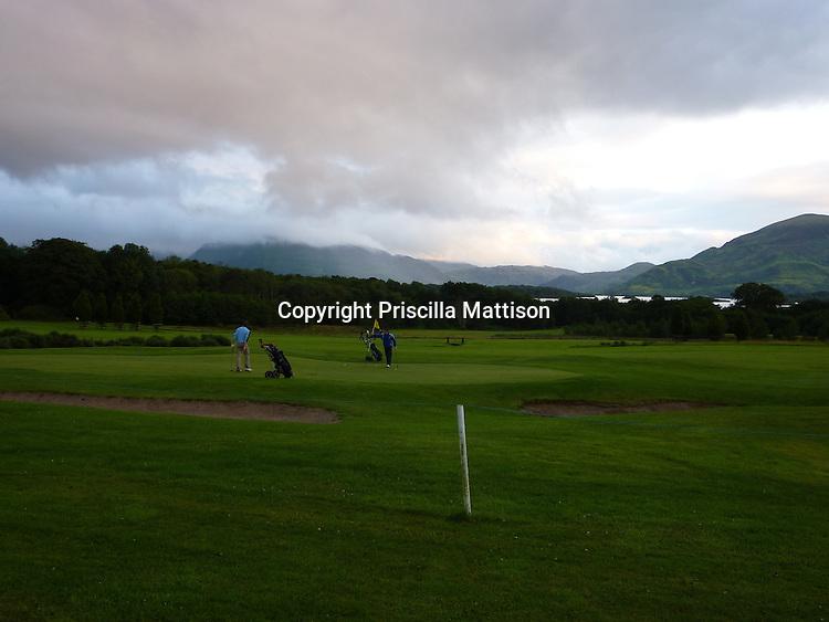 County Kerry, Republic of Ireland - July 19, 2010:  Golfers play at sundown.