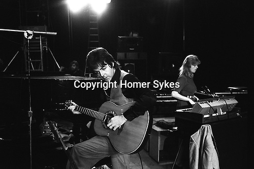 """Paul and Linda McCartney Wings Tour 1975. Sound check at the Elstree rehearsal studio London England.. The photographs from this set were taken in 1975. I was on tour with them for a children's """"Fact Book"""". This book was called, The Facts about a Pop Group Featuring Wings. Introduced by Paul McCartney, published by G.Whizzard. They had recently recorded albums, Wildlife, Red Rose Speedway, Band on the Run and Venus and Mars. I believe it was the English leg of Wings Over the World tour. But as I recall they were promoting,  Band on the Run and Venus and Mars in particular."""