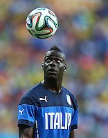 Mario Balotelli of Italy watches the ball during the warm up