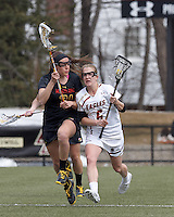 Boston College midfielder Sarah Mannelly (6) brings the ball forward as University of Maryland midfielder Taylor Cummings (21) defends..University of Maryland (black) defeated Boston College (white), 13-5, on the Newton Campus Lacrosse Field at Boston College, on March 16, 2013.