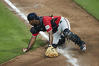 Carolina Mudcats catcher Zavier Warren (6) blocks a throw at home plate during the game against the Kannapolis Cannon Ballers at Atrium Health Ballpark on June 9, 2021 in Kannapolis, North Carolina. (Brian Westerholt/Four Seam Images)