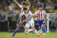 Pasadena, CA - Tuesday June 07, 2016: Paraguay midfielder Oscar Romero (21) and Colombia midfielder James Rodríguez (10) during a Copa America Centenario Group A match between Colombia (COL) and Paraguay (PAR) at Rose Bowl Stadium.