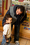 Education preschool 3-4 year olds start of day separation father leaning down to say goodbye to son at start of day vertical