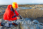 Isabella O'Mahony taking photos of the newly discovered fossils on Ballybunion Beach on Friday