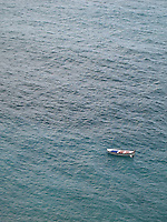 A rowboat floats on the Mediterranean, Italy