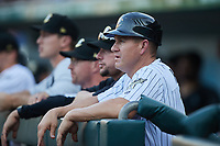 Charlotte Knights manager Wes Helms (18) watches from the dugout during the game against the Nashville Sounds at Truist Field on June 4, 2021 in Charlotte, North Carolina. (Brian Westerholt/Four Seam Images)