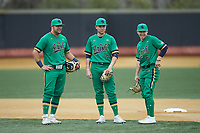 (L-R) Notre Dame Fighting Irish infielders Niko Kavadas (12), Jared Miller (16), and Ethan Copeland (6) wait for the game against the Wake Forest Demon Deacons to resume at David F. Couch Ballpark on March 10, 2019 in  Winston-Salem, North Carolina. The Demon Deacons defeated the Fighting Irish 7-4 in game one of a double-header.  (Brian Westerholt/Four Seam Images)