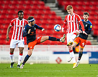20th February 2021; Bet365 Stadium, Stoke, Staffordshire, England; English Football League Championship Football, Stoke City versus Luton Town; Sam Clucas of Stoke City is tackled by Jordan Clark of Luton Town