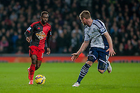 WEST BROMWICH, ENGLAND - FEBRUARY 11: Nathan Dyer of Swansea City tries to take the ball past Chris Brunt of West Bromwich Albion   during the Premier League match between West Bromwich Albion and Swansea City at The Hawthorns on February 11, 2015 in West Bromwich, England. (Photo by Athena Pictures/Getty Images)