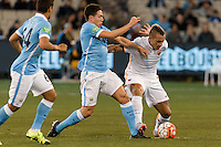 Melbourne, 21 July 2015 - Samir Nasri of Manchester City and Radja Nainggolan of AS Roma fight for the ball in game two of the International Champions Cup match at the Melbourne Cricket Ground, Australia. City def Roma 5-4 in Penalties. (Photo Sydney Low / AsteriskImages.com)