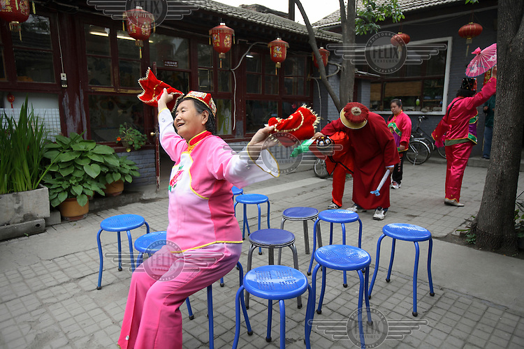 Students prepare to perform for Western visitors at the Huiling School in Beijing, a privately funded centre for the mentally handicapped.
