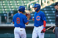 AZL Cubs 1 Fabian Pertuz (12) congratulates Henderson Perez (8) after scoring during an Arizona League game against the AZL Padres 1 on July 5, 2019 at Sloan Park in Mesa, Arizona. The AZL Cubs 1 defeated the AZL Padres 1 9-3. (Zachary Lucy/Four Seam Images)