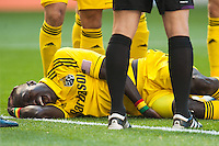 Forward Dominic Oduro (11) of the Columbus Crew lays injured on the pitch after scoring early in the first half against the New York Red Bulls during a Major League Soccer (MLS) match at Red Bull Arena in Harrison, NJ, on May 26, 2013.