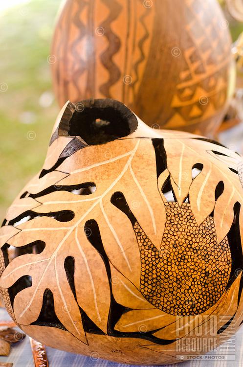 Laua'e leaf design painted Hawaiian gourd, (ipus) displayed at a craft fair, Honolulu, O'ahu.