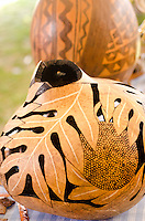 Laua'e leaf design painted Hawaiian gourd, (ipus) displayed at a craft fair, Honolulu, O'ahu.