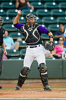 Winston-Salem Dash catcher Kevan Smith (24) throws the ball back to his pitcher during the Carolina League game against the Wilmington Blue Rocks at BB&T Ballpark on August 3, 2013 in Winston-Salem, North Carolina.  The Blue Rocks defeated the Dash 4-2.  (Brian Westerholt/Four Seam Images)