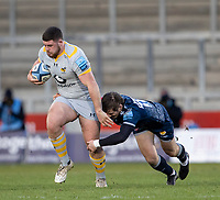 27th December 2020; AJ Bell Stadium, Salford, Lancashire, England; English Premiership Rugby, Sale Sharks versus Wasps; Alfie Barbeary of Wasps is tackled by AJ Macginty of Sale Sharks
