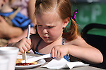 Kiera Favero, 5, enjoys her breakfast at the Summer Reading Program Pancake Breakfast Kick-Off at the Carson City Library, in Carson City, Nev., on Saturday, June 8, 2013. <br /> Photo by Cathleen Allison