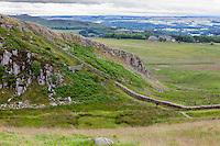 Northumberland,  England, UK.  Walking toward Peel Crags from Steel Rigg, Hadrian's Wall (Pennine Way) Footpath.