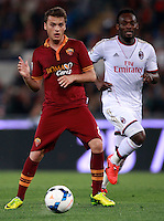 Calcio, Serie A: Roma vs Milan. Roma, stadio Olimpico, 25 aprile 2014.<br /> AS Roma forward Adem Ljajic, of Serbia, is chased by AC Milan midfielder Michael Essien, of Ghana, right, during the Italian Serie A football match between AS Roma and AC Milan at Rome's Olympic stadium, 25 April 2014.<br /> UPDATE IMAGES PRESS/Isabella Bonotto