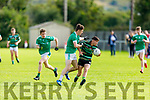 St Brendans Dara O'Connor been put under pressure from Dominic Finnegan of St Kierans in the County Minor Football Championship.