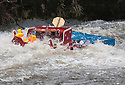 26/12/15<br /> <br /> Santa's sleigh is capsized.<br /> <br /> Dozens of competitors are tossed into the Derwent as the extremely swollen river launches rafts, uncontrollably, down a weir along the route of the Boxing Day Race at Matlock Bath in Derbyshire.<br /> <br /> <br /> All Rights Reserved: F Stop Press Ltd. +44(0)1335 418365   www.fstoppress.com.