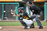 Luis Martinez (20) of the Salt Lake Bees behind the plate with home plate umpire Roberto Ortiz in action against the Sacramento River Cats at Smith's Ballpark on April 5, 2014 in Salt Lake City, Utah.  (Stephen Smith/Four Seam Images)