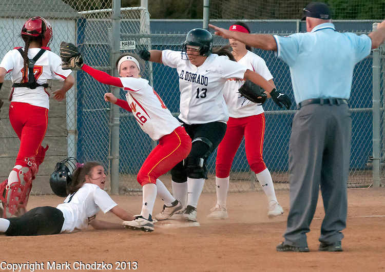 Rosary's Payton Lawton, 16, looks to the umpire for help sorting out this rundown against El Dorado.<br /> ///ADDITIONAL INFORMATION:<br /> 4/17/13, MARK CHODZKO, FOR THE REGISTER<br /> El Dorado @ Rosary, Softball, at CAL STATE FULLERTON, non-league.