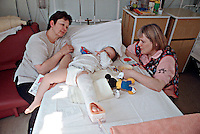 Paediatric nurse with a child confined to bed in the paediatric ward. The child is in traction due to a broken leg. This image may only be used to portray the subject in a positive manner..©shoutpictures.com..john@shoutpictures.com