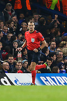 Referee, Mr Pavel Kralovec retrieves a drink bottle thrown onto the field from the Dynamo Kyiv supporters end of the stadium during the UEFA Champions League Group match between Chelsea and Dynamo Kyiv at Stamford Bridge, London, England on 4 November 2015. Photo by David Horn.