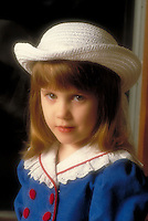 Portrait of a young girl in Easter Sunday dress and white hat.