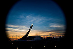 Olympic flame burning and Bolshoy Ice Dome silhouetted against a sunset sky during the 2014 Sochi Olympic Winter Games at the Olympic Park on February 8, 2014 in Sochi, Russia. Photo by Victor Fraile / Power Sport Images