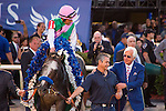 HALLANDALE BEACH, FL - JANUARY 28: Arrogate with jockey Mike Smith up celebrates with groom Eduardo Luna and trainer Bob Baffert after cruising to victory in the Pegasus World Cup Day at Gulfstream Park. (Photo by Arron Haggart/Eclipse Sportswire/Getty Images