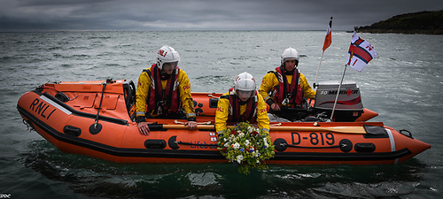 Crew on Fethard's D-Class lifeboat lay a wreath