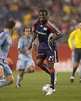 New England Revolution midfielder Shalrie Joseph (21) passes backwards. The New England Revolution tied the Colorado Rapids, 1-1, at Gillette Stadium on May 16, 2009.