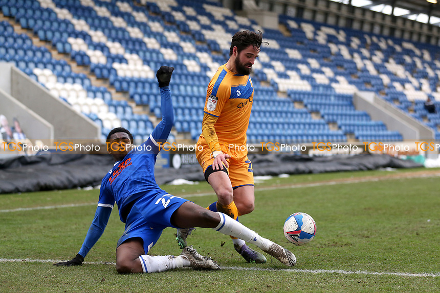 Kwame Poku of Colchester United and Stephen McLaughlin of Mansfield Town during Colchester United vs Mansfield Town, Sky Bet EFL League 2 Football at the JobServe Community Stadium on 14th February 2021