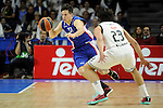 Real Madrid´s Sergio Llull and Anadolu Efes´s Thomas Heurtel during 2014-15 Euroleague Basketball Playoffs second match between Real Madrid and Anadolu Efes at Palacio de los Deportes stadium in Madrid, Spain. April 17, 2015. (ALTERPHOTOS/Luis Fernandez)