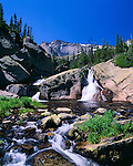 Glacier Creek waterfall under deep blue sky, summer morning in Rocky Mountain National Park, Colorado, USA
