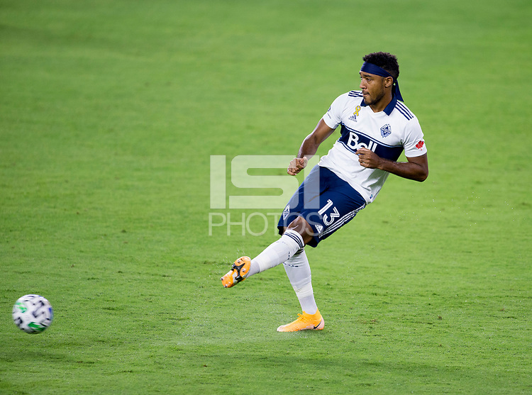 LOS ANGELES, CA - SEPTEMBER 23: Derek Cornelius #13 of the Vancouver Whitecaps passes the ball during a game between Vancouver Whitecaps and Los Angeles FC at Banc of California Stadium on September 23, 2020 in Los Angeles, California.