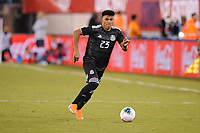 EAST RUTHERFORD, NJ - SEPTEMBER 7: Jesus Gallardo #23 of Mexico kicks the ball during a game between Mexico and USMNT at MetLife Stadium on September 6, 2019 in East Rutherford, New Jersey.