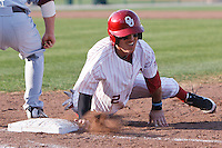 Cale Ellis (2) dives back to first during the NCAA matchup between the University of Arkansas-Little Rock Trojans and the University of Oklahoma Sooners at L. Dale Mitchell Park in Norman, Oklahoma; March 11th, 2011.  Oklahoma won 11-3.  Photo by William Purnell/Four Seam Images