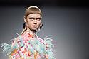 Nastya Kusakina poses a Maria Escote's creation during the MBFW Madrid (Mercedes Benz Fashion Week Madrid) Autumn/Winter at IFEMA in Madrid on January 25, 2018.