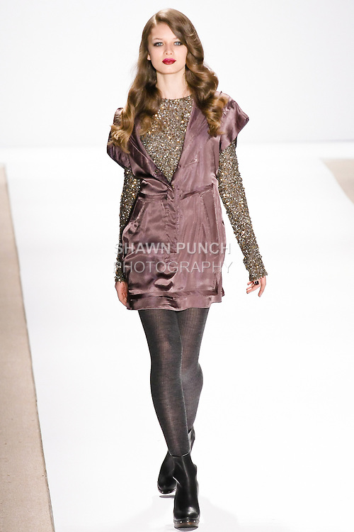 Katya Kulyzha walks the runway in an olive hooded dress, and olive beaded t-shirt, by Nanette Lepore, for her Nanette Lepore Fall 2010 collection fashion show, during Mercedes-Benz Fashion Week Fall 2010.