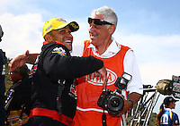 Jul. 20, 2014; Morrison, CO, USA; NHRA photographer Jon Asher (right) congratulates top fuel driver J.R.Todd after winning the Mile High Nationals at Bandimere Speedway. Mandatory Credit: Mark J. Rebilas-