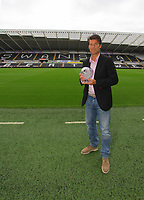 Pictured: Swansea manager Michael Laudrup with the F&C Investments League Managers Association  (LMA)performance of the week award for his team's performance against Queens Park Rangers. Thursday 23 August 2012<br />
