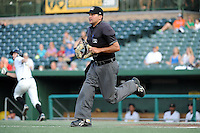 Umpire Charlie Ramos gets in position to make a call during a game between the South Bend Silver Hawks and Bowling Green Hot Rods on August 20, 2013 at Stanley Coveleski Stadium in South Bend, Indiana.  Bowling Green defeated South Bend 3-2.  (Mike Janes/Four Seam Images)