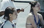 TWO GIRLS GET HAIR BRAIDED ON STREET IN SAN FELIPE